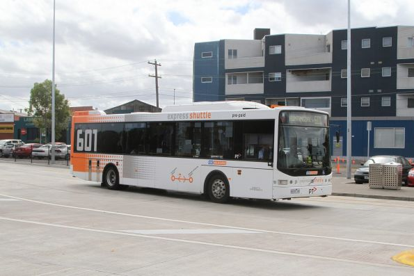 CDC Melbourne bus #130 8414AO on route 601 departs Huntingdale station
