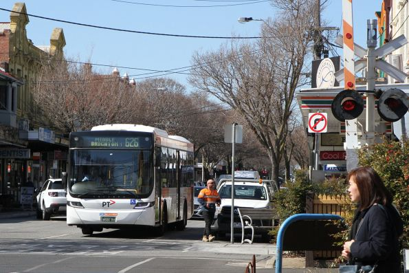 CDC Melbourne bus BS00RM on route 626 crosses the Bay Street level crossing on the Sandringham line at North Brighton station