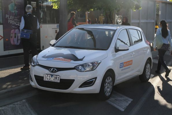 CDC Melbourne changeover car with 'Movember' moustache at Sunshine station