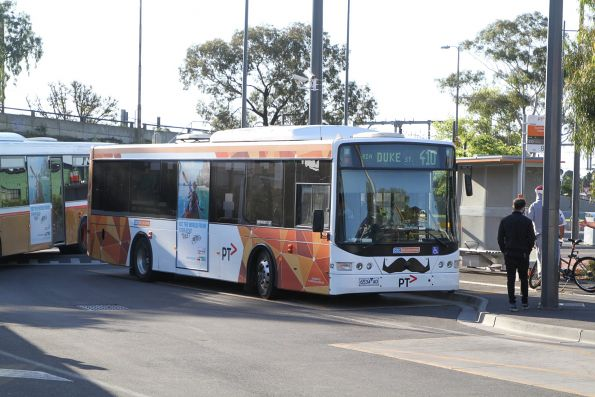 CDC Melbourne bus #82 6534AO with 'Movember' moustache on route 410 at Sunshine station