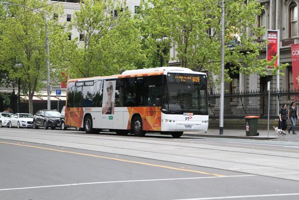 CDC Melbourne bus #33 1033AO on route 605 outside Flagstaff station
