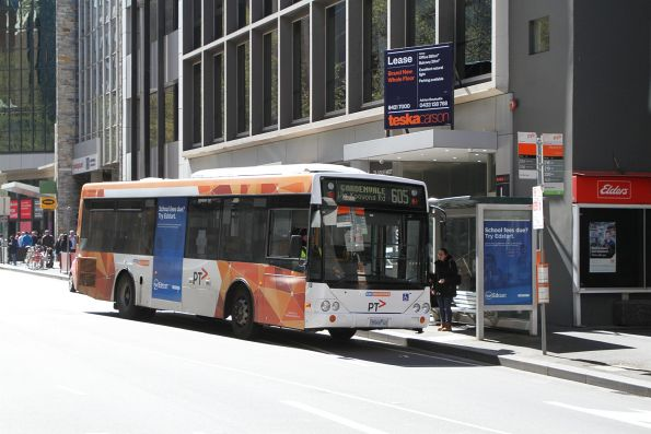 CDC Melbourne bus #69 5569AO heads south on route 605 at Queen and Bourke Street