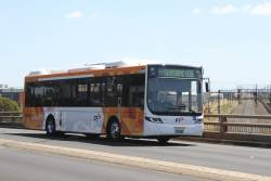 CDC Melbourne hybrid bus #118 BS05HO on route 408 along McIntyre Road, Sunshine North