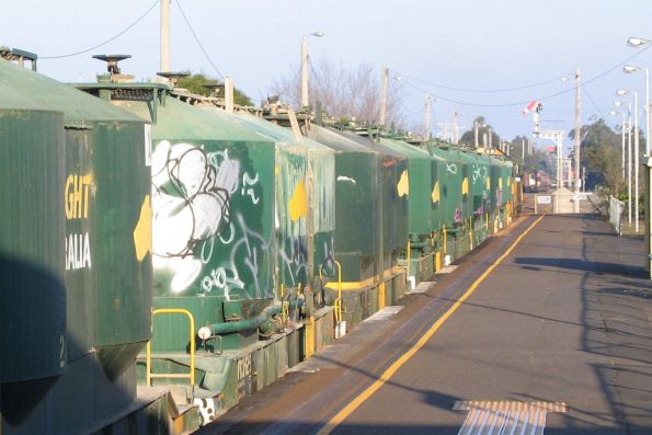 Signal at proceed for X31, in the background a pass train is stabled in Siding B