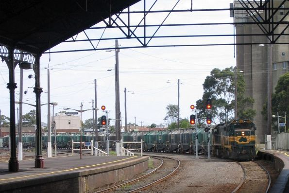 H2 leads X36 on the down cement train through Geelong station