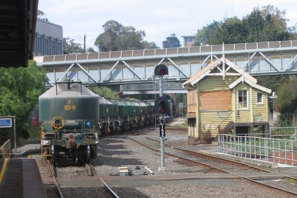 H2 leads X36 on the down cement train through the Geelong tunnel