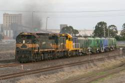 X36, H4 and H1 depart North Shore with a mix of cement and grain wagons