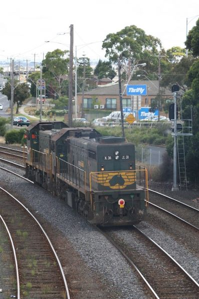 H2 and X31 return light engine from the Waurn Ponds cement run, at Geelong