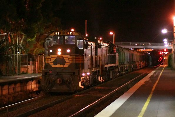 H2 leads an unknown X class on the up Waurn Ponds cement at North Geelong