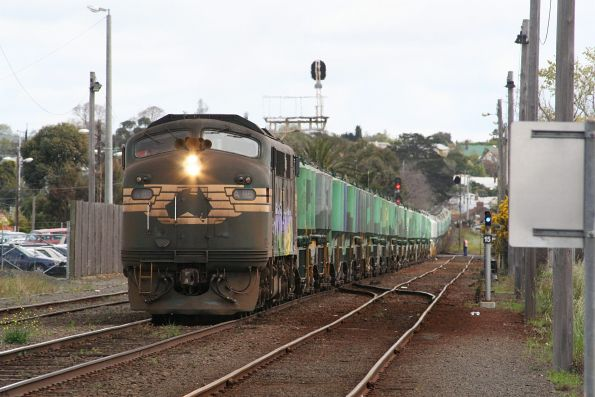 A85 departs South Geelong for Waurn Ponds with cement hoppers