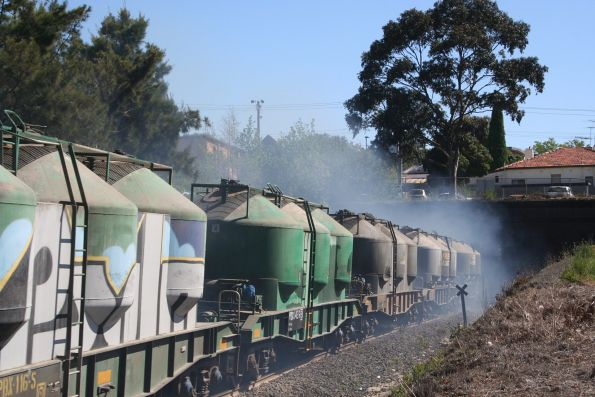 Smoke billows out of the Geelong Tunnel as a down cement train exits