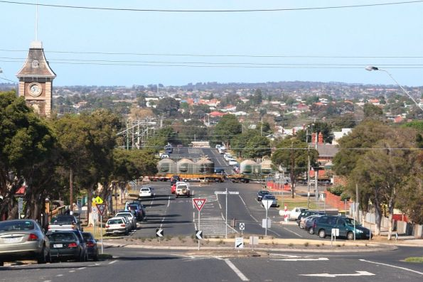 Down cement train crosses the Yarra Street level crossing at South Geelong