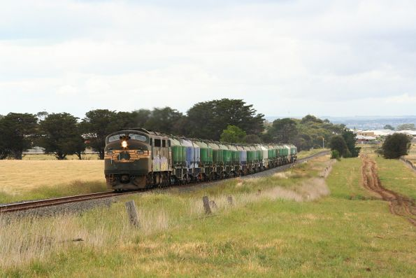 A85 leads the down cement train at Grovedale