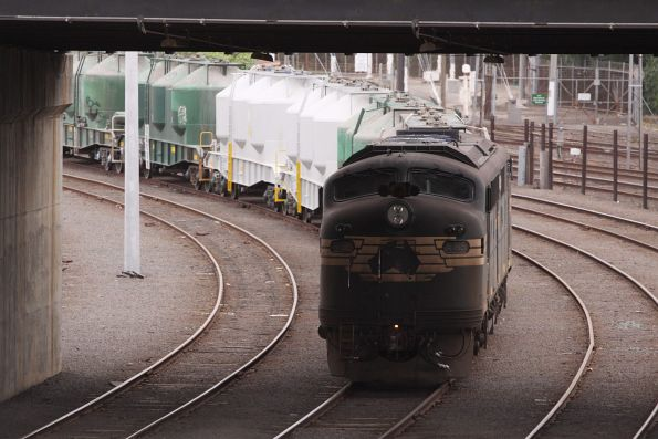 A85 lurks under the Dynon Road bridge at Melbourne Yard with a rake of cement hoppers