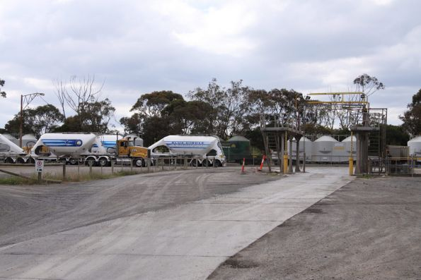 A few cement hoppers in the sidings at Waurn Ponds, along with a lot of B double trucks