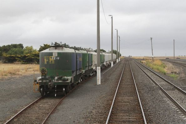 Stabled cement hoppers in the siding at Gheringhap, waiting their trip north to Mildura