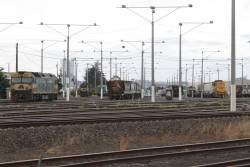 G524 and T400 stabled at North Geelong Yard with a mix of grain and cement wagons