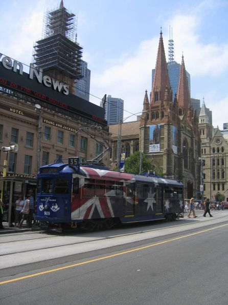 SW6.909 in Australia Day livery eastbound at Flinders and Swanston Street