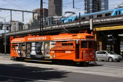 SW6.866 advertising Old Melbourne Gaol on the City Circle westbound alone Flinders Street