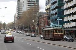 W6.983 heads south without passengers at the corner of Spencer and Bourke Street