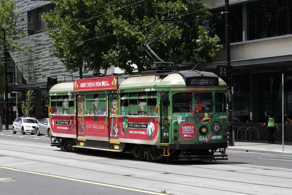 SW6.866 in a Christmas livery heads west at La Trobe and Spencer Street