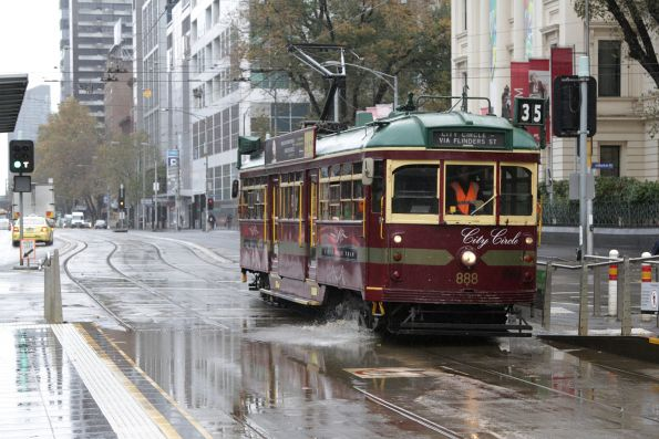 SW6.888 passes through floodwater at Flinders and Market Streets