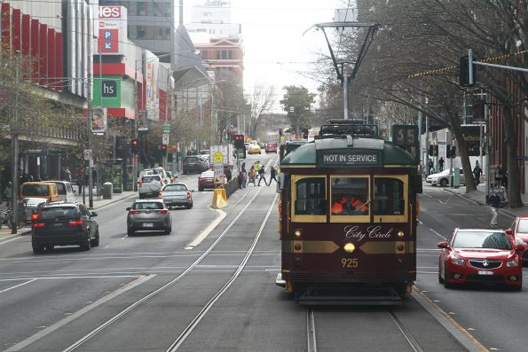 SW6.925 heads out of service southbound at Spencer and Little Bourke Street