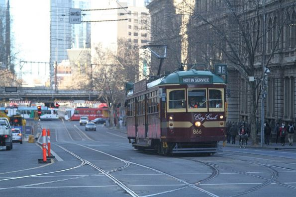 SW6.866 heads north out of service at Spencer and Collins Street