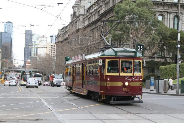 W7.1020 heads north at Spencer and Collins Street
