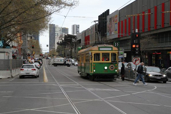 W8.1010 heads north at Spencer and Lonsdale Street car out from Southbank Depot