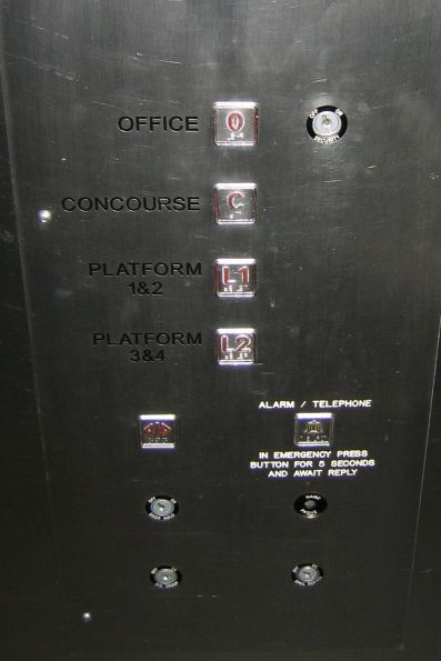 Lift buttons at Melbourne Central: the top floor is the stationmaster's office
