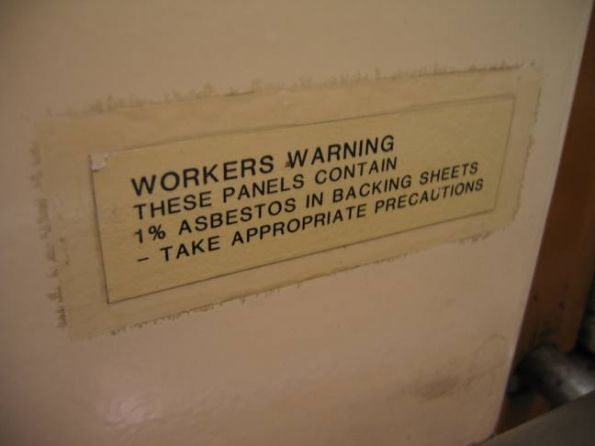 Asbestos warning on wall panel at Flagstaff station