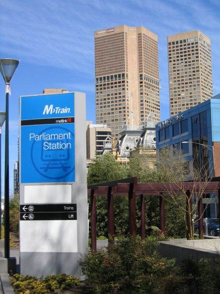 M>Train and Metlink branded sign outside the Lonsdale Street entrance to Parliament Station