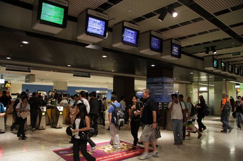 TV screens and ticket barriers at the Swanston Street end of Melbourne Central