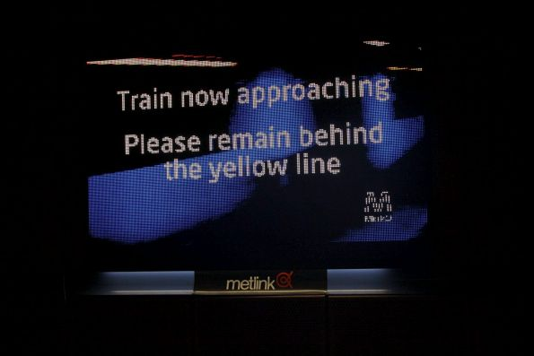 'Train now approaching. Please remain behind the yellow line' message on the LED screen at Melbourne Central platform 3
