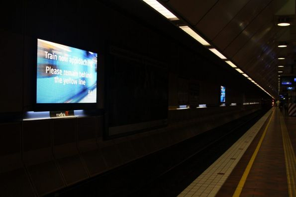 LED screens at Melbourne Central platform 3, displaying a safety message triggered by approaching trains