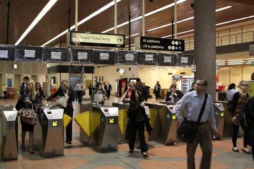 Metcard barriers at Flagstaff Station, with the new LCD next train displays behind