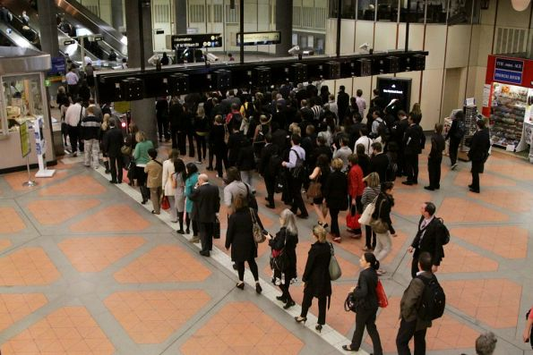 The gates are locked open, but the queues at Flagstaff station remain