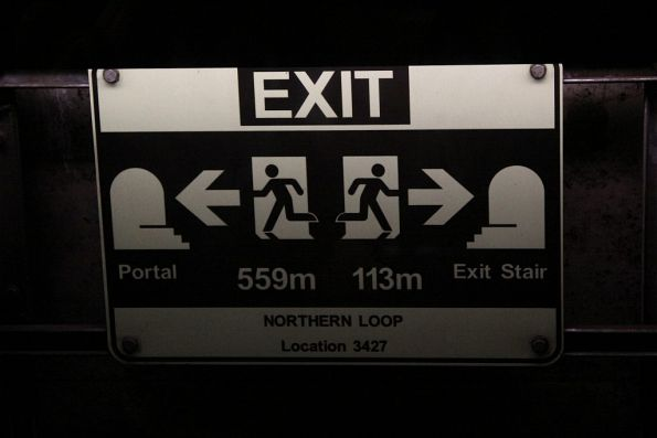 Emergency exit signage in the Northern Loop between Flagstaff station and North Melbourne