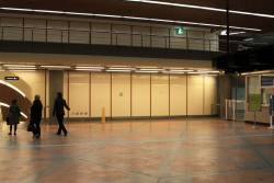 Empty wall on the Flagstaff station concourse, where a cafe used to be