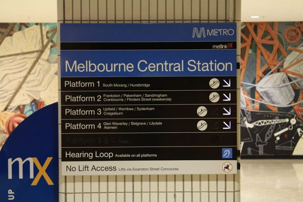 Illuminated platform directional signage at Melbourne Central