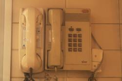 Staff telephones in the City Loop: SEPAC phone with VicRail logo to the left, PABX phone with V/Line logo to the right
