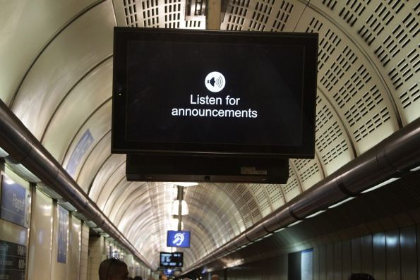 'Listen for announcements' message displayed on just one of the screens at Flagstaff station