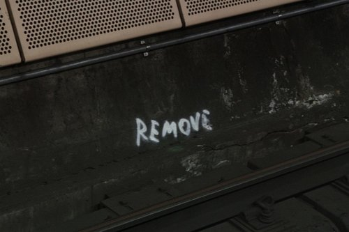 I would hope the 'REMOVE' text relates to the cracked concrete along the tunnel floor!