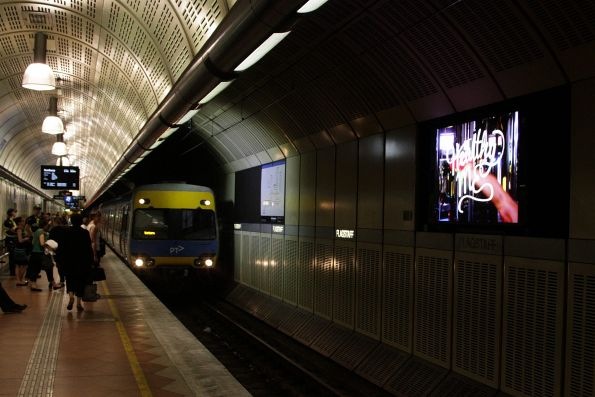 Another LED advertising screen failing to turn off for the arrival of a train