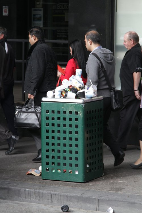 Rubbish bin overflowing with coffee cups outside Flagstaff station