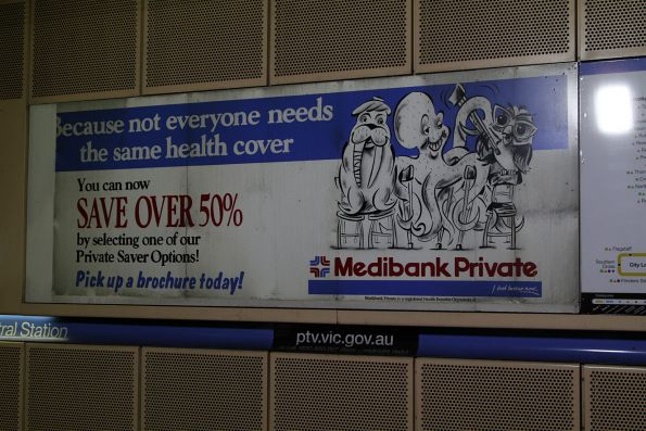 Ancient advertisement for 'Medibank Private' still in place at Melbourne Central platform 1