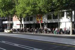 Pedestrian congestion outside Flagstaff station on William Street