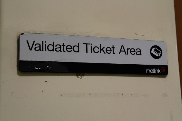 'Connex' and 'Metlink' branding exposed on a 'Validated Ticket Area' sign
