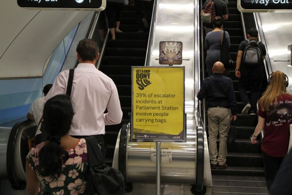 'Get a grip, don't slip' campaign signage at the Parliament station escalators